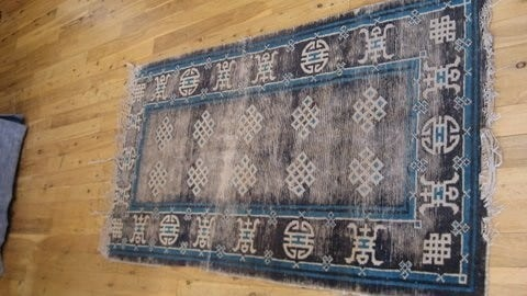 antique rug before